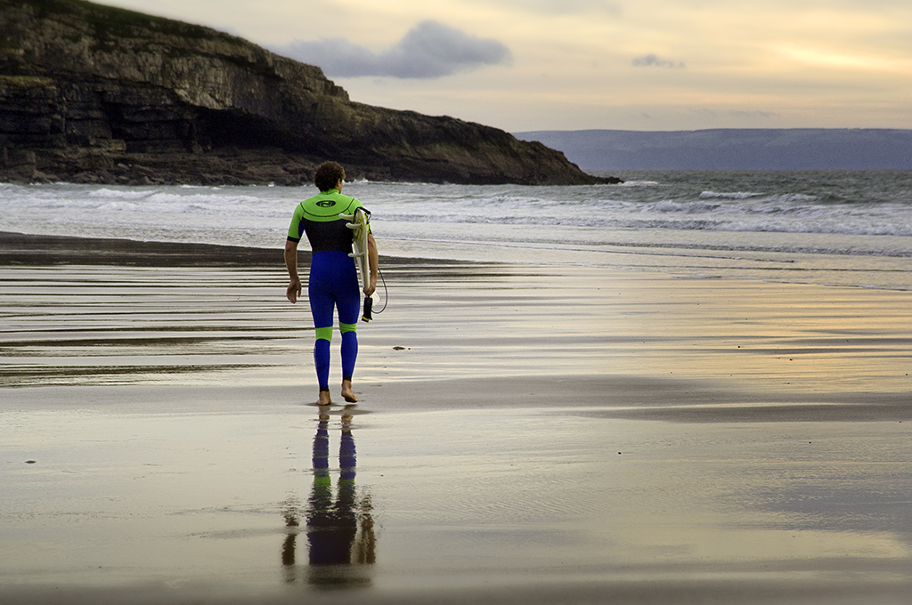 Surfer on Dunraven Beach Porthcawl Glamorgan Heritage Coast South Wales